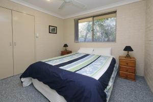 A bed or beds in a room at ACACIA - WEEKLY ONLY