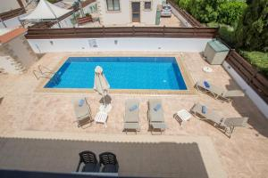A view of the pool at Zouvanis Luxury Villas or nearby