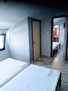 Ένα ή περισσότερα κρεβάτια σε δωμάτιο στο Nouvelle