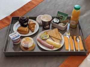 Breakfast options available to guests at Orange Hotel La Louvière