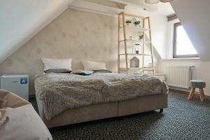 Łóżko lub łóżka w pokoju w obiekcie Armada Apart Ustka