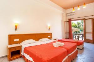 Ένα ή περισσότερα κρεβάτια σε δωμάτιο στο Aquarius Beach Hotel