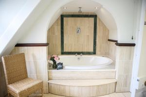 A bathroom at Langshott Manor - Luxury Hotel Gatwick