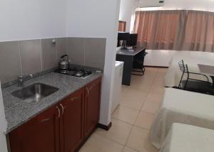 A kitchen or kitchenette at Apart Hotel Alvear