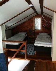Vuode tai vuoteita majoituspaikassa Kirkkokadun Amanda ja Olga