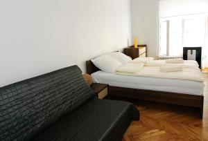 Posteľ alebo postele v izbe v ubytovaní P&J Apartments Floriańska