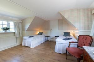 Säng eller sängar i ett rum på Husargårdens Bed & Breakfast