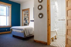 A bed or beds in a room at 11th Avenue Hostel
