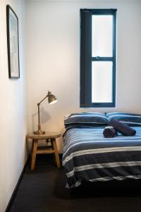 A bed or beds in a room at Wake Up! Bondi Beach