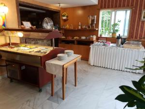 A restaurant or other place to eat at Mirana Family Hotel