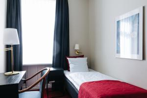 A bed or beds in a room at City Hotel Nebo