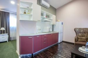 A kitchen or kitchenette at Sport Point Hotel