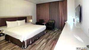 富立登國際大飯店房間的床