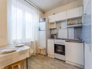 Кухня или мини-кухня в Апартаменты Ханака Щёлковское 46
