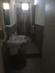 Salle de bains dans l'établissement Hotel Faraglione