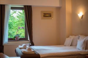 Cama o camas de una habitación en Hotel Marami