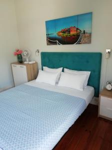 A bed or beds in a room at Casa Azul Hostel
