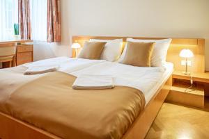 Postel nebo postele na pokoji v ubytování Villa Marion
