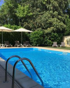 The swimming pool at or near Europ'Hotel Bergerac