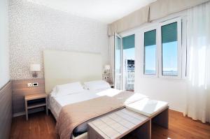Postel nebo postele na pokoji v ubytování Hotel Splendid