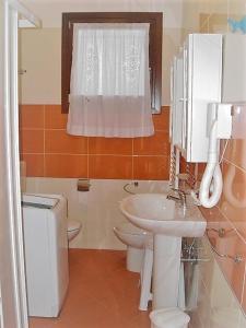 Koupelna v ubytování Residence Villaggio Dei Fiori