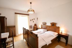 Ein Bett oder Betten in einem Zimmer der Unterkunft Ferienwohnung Leutschach