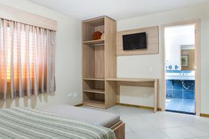 A bed or beds in a room at Hotel Suárez Campo Bom