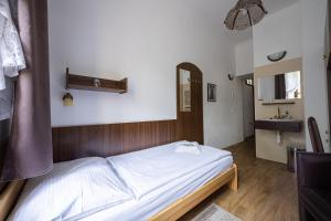 A bed or beds in a room at Pension City