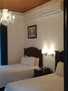 A bed or beds in a room at Hotel Luna