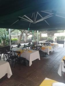 A restaurant or other place to eat at Hotel Luna