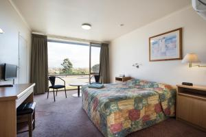 A bed or beds in a room at Morwell Hotel