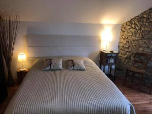 Un ou plusieurs lits dans un hébergement de l'établissement Chambres d'Hôtes La Vallée des Vignes