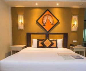 Кровать или кровати в номере Ellaidhoo Maldives by Cinnamon