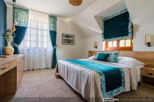 A bed or beds in a room at Bock Hotel Ermitage