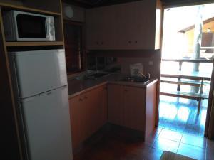 Una cocina o zona de cocina en Complejo Turístico & Camping Cabopino