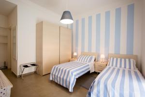 Affittacamere Le Camere Nel Corso 객실 침대