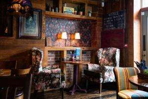 The lounge or bar area at The Amble Inn