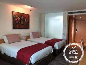 Uma cama ou camas num quarto em VIP Executive Entrecampos - Hotel & Conference