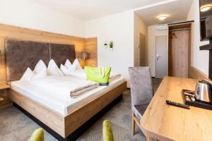 A bed or beds in a room at Hotel Restaurant Urdlwirt