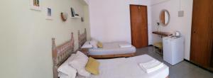 Postel nebo postele na pokoji v ubytování Saturno