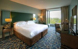 A bed or beds in a room at Hilton Dublin Kilmainham