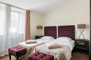 A bed or beds in a room at Amberton Cathedral Square Hotel Vilnius
