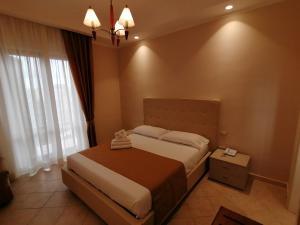 A bed or beds in a room at Azienda Agrituristica Vivi Natura