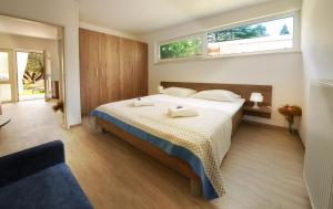 A bed or beds in a room at Adria Apartments - Hotel & Resort Adria Ankaran