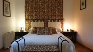 Uma cama ou camas num quarto em Quinta da Bacelada - Casa do Redondo
