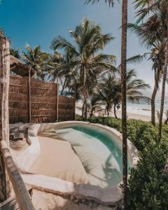 The swimming pool at or close to Papaya Playa Project