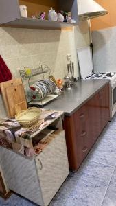 A kitchen or kitchenette at Vacation home on ulitsa Lienina 5