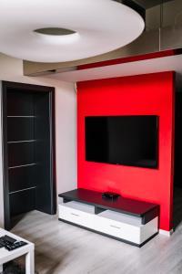 Televízia a/alebo spoločenská miestnosť v ubytovaní AH Luxury Baštová 10