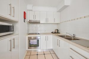 A kitchen or kitchenette at Beaches Twelve