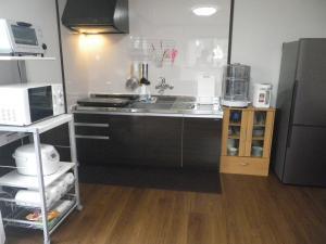民宿 いわかわにあるキッチンまたは簡易キッチン